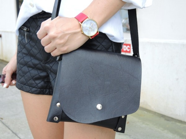 quilted leather shorts with black bag and red world map watch